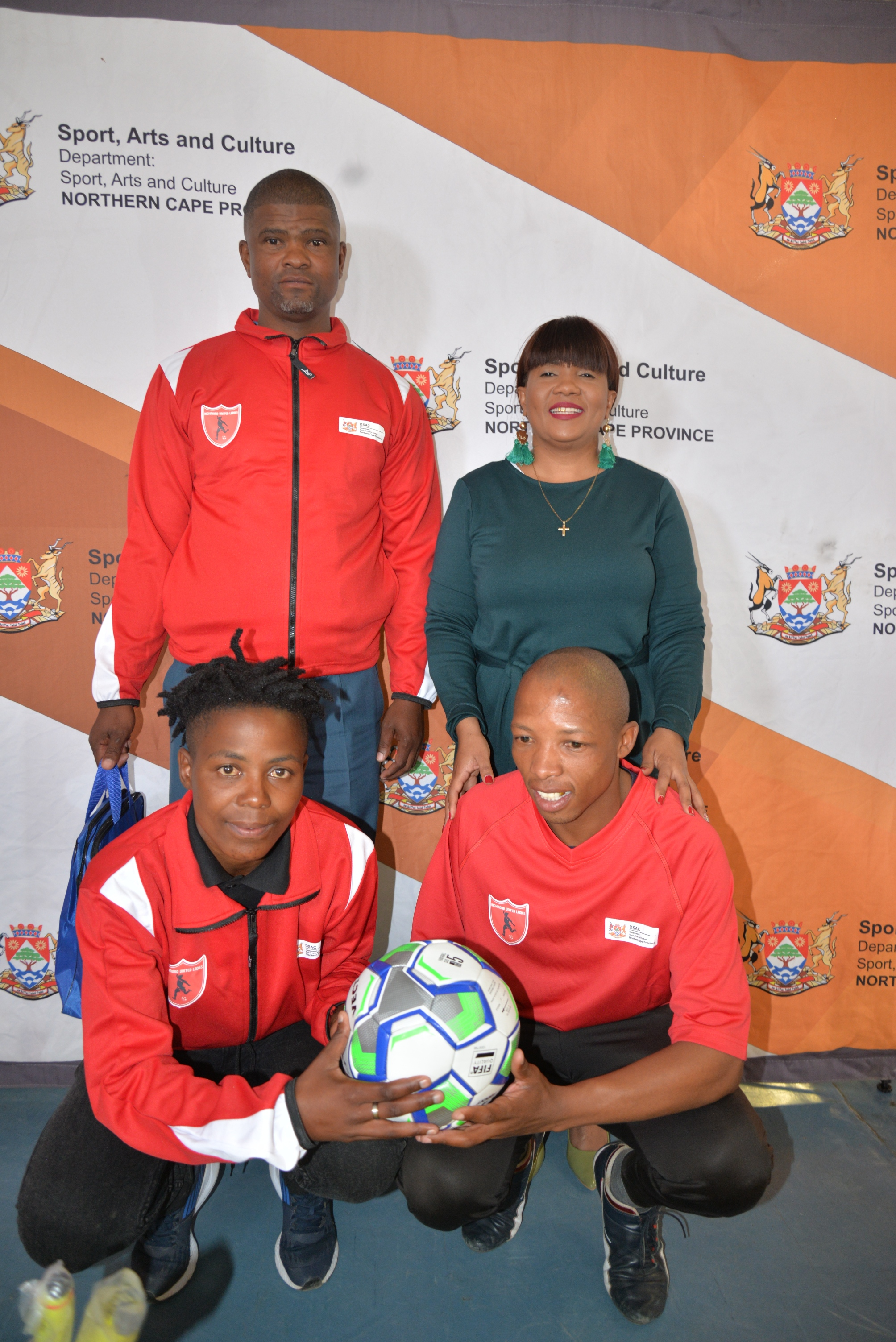 back from left to right  Armichand Amsterdam ( Owner of the Club) MEC for Sport , Arts and Culture Ms Bernice Sinxeve  front from left to right  Noxolo Nongxuso (captain ) and Tshupo Mogajane ( Coach)