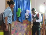 Raising awareness on children's rights and protection to children through an educational puppet show.